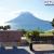 薩摩長崎鼻の白い灯台と千畳敷、そして開聞岳を眺める