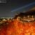 清水寺 紅く染まった紅葉ライトアップと青い光線、白く輝く京都市内